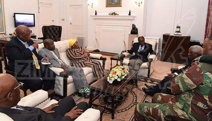 Photos Of Robert Mugabe Negotiating With Army Commander And Others.