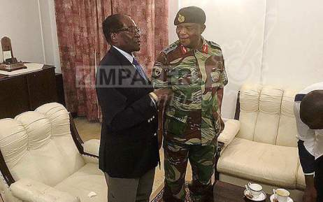 Photos Of Robert Mugabe Negotiating With Army Commander